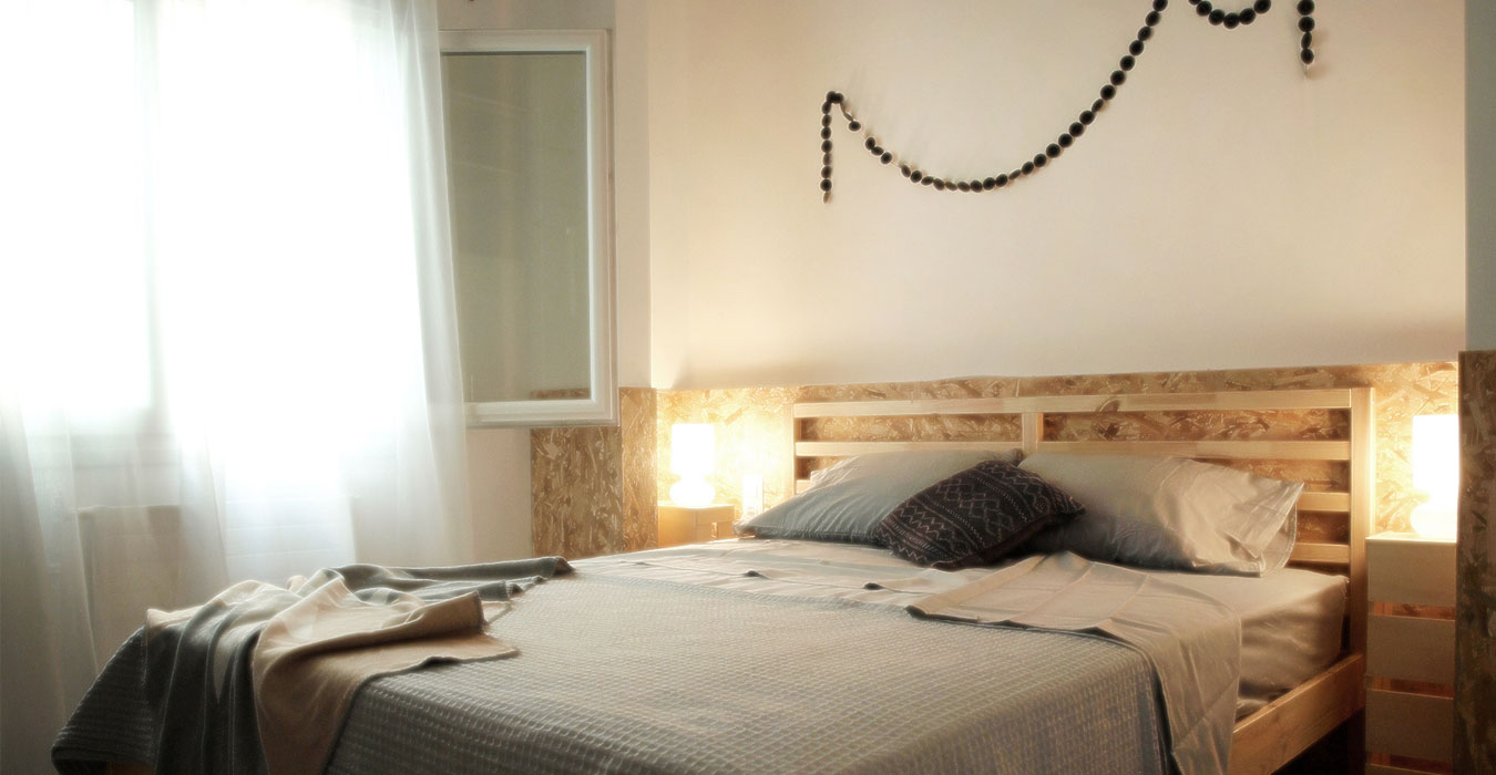 Urban interior design with indirect lighting behind osb headboard