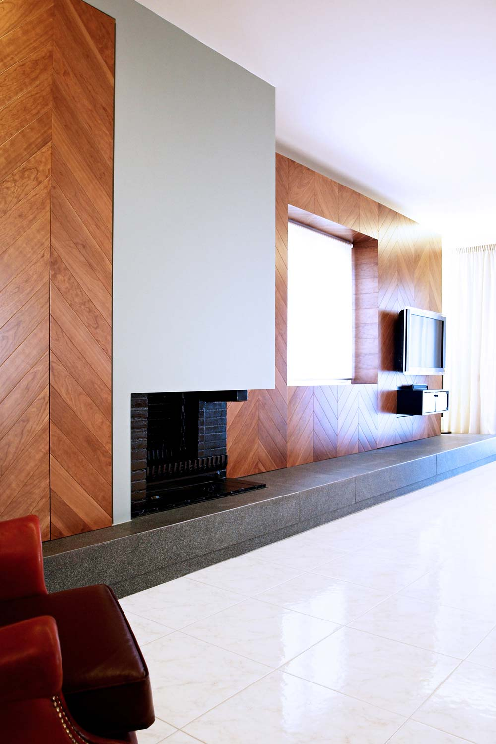 The shell of the existing fireplace was constructed and transformed.