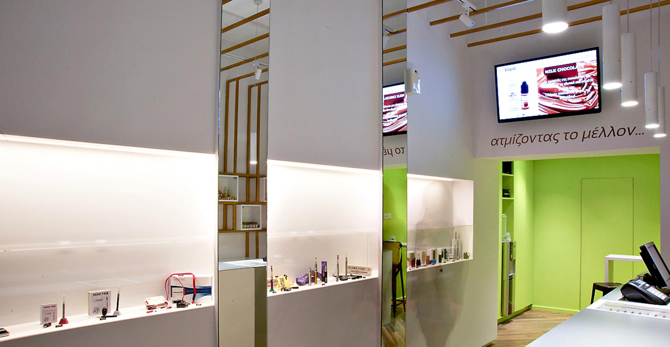 Franchise retail design with minimal cases and vertical mirror surfaces.